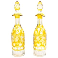 Early 20th Century Pair of Cut-Glass Amber Engraved Decanters