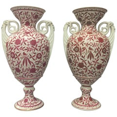 Pair of Bohemian Porcelain Amphoras with Gilt Rosewood Floral and Foliate Motifs