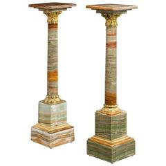 Pair of Amber Colored African Onyx Columns with Revolving Tops