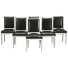 French Louis XVI Style Dining Chairs in Black Leather and Distressed White Paint