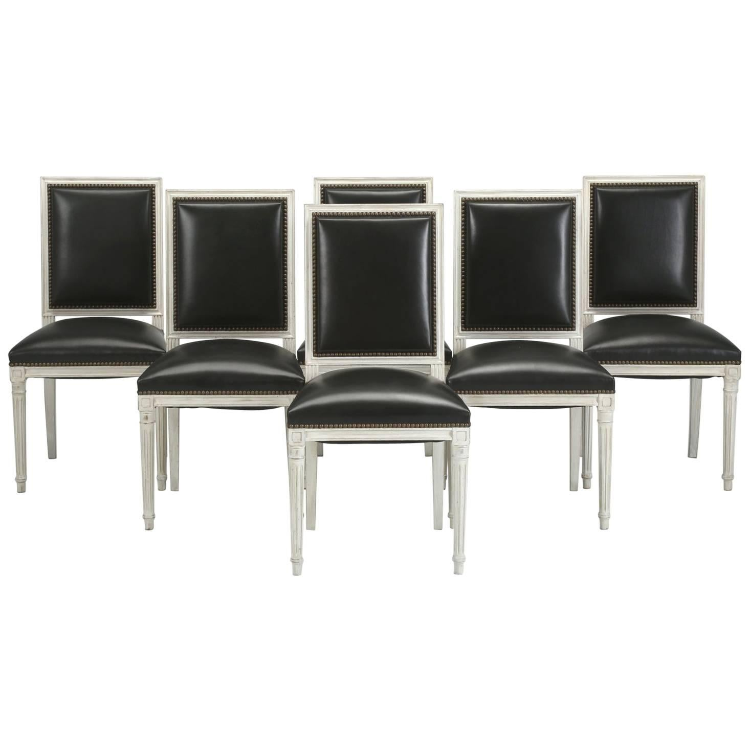 French Louis XVI Style Dining Chairs In Black Leather And Distressed White  Paint For Sale