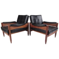 Pair of Scandinavian Modern Teak and Vinyl Lounge Chairs