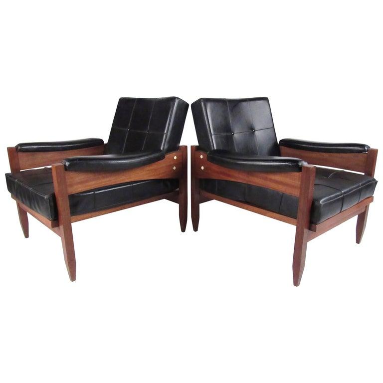 Pair of Scandinavian Modern Teak and Vinyl Lounge Chairs For Sale