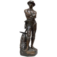 Bronze Figure of a Miner