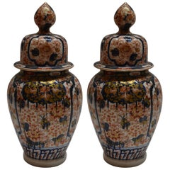 Pair of Antique Imari Vases and Covers