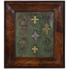 Walnut Framed Collection of Bronze and Silvered Crosses, 19th Century or Earlier