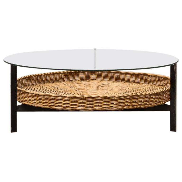 Modernist two tiered round coffee table with rattan basket at 1stdibs Coffee table with wicker baskets