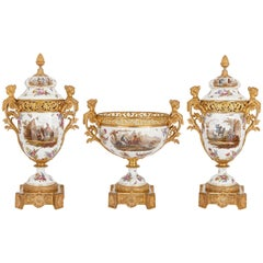 French Neoclassical Style Ormolu and Sèvres Porcelain Three-Piece Garniture