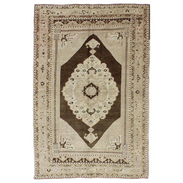Brown Background Vintage Turkish Oushak Rug with Intricate Floral Medallion