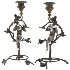 Pair of French Turn of the Century Brass and Porcelain Monkey Candlesticks
