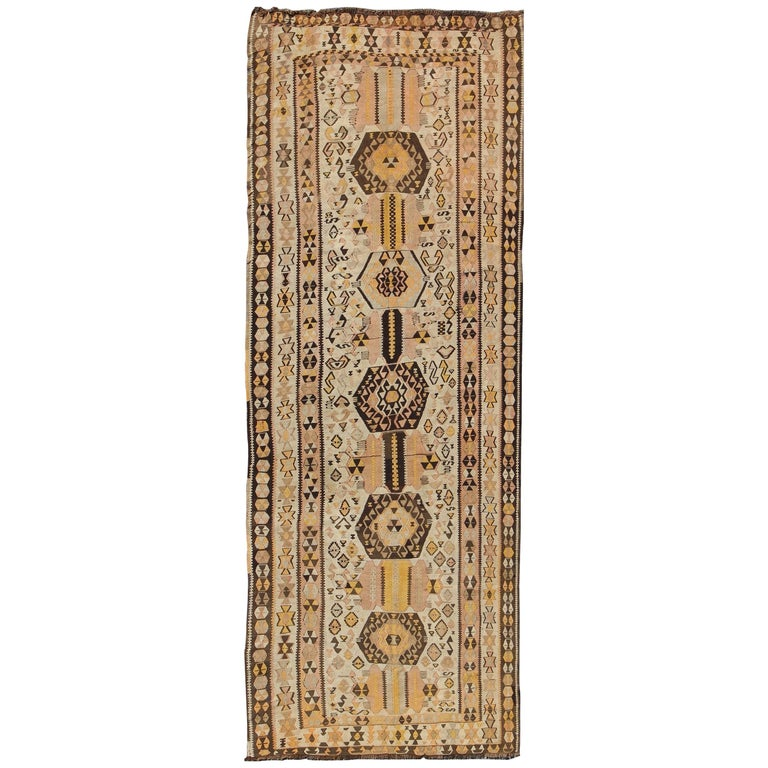 Vintage Turkish Kilim Gallery Rug with Tribal Design in Brown, Pink and Yellow