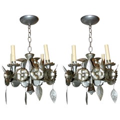 Pair of Silver Tin Chandeliers