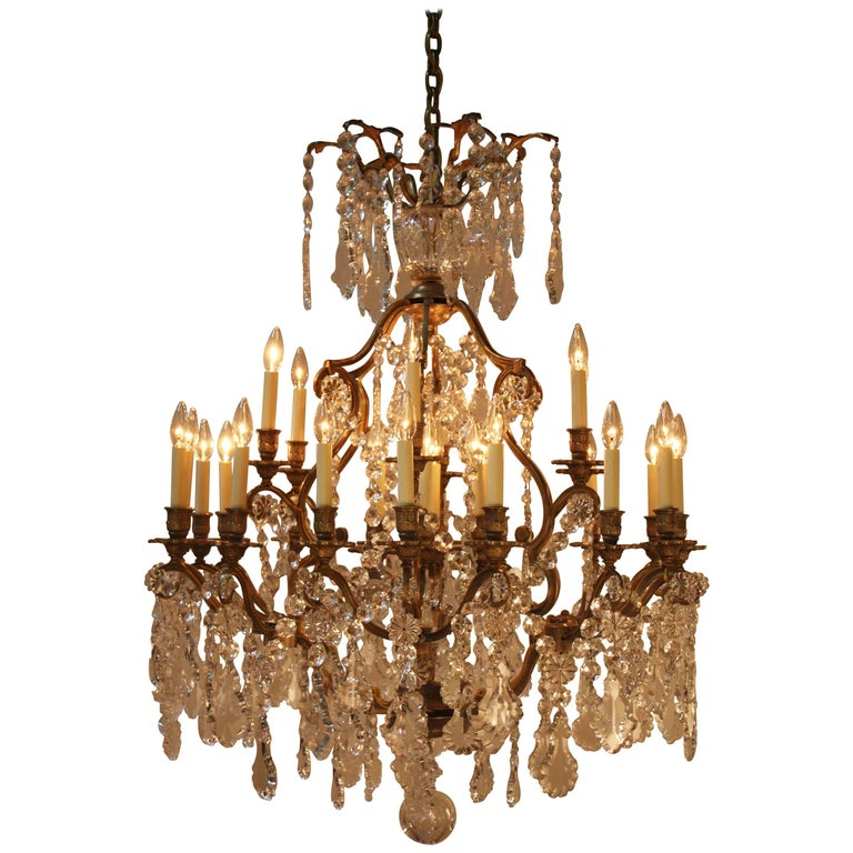 French Bronze And Crystal Thirty Light Chandelier For Sale