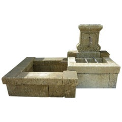 Ancient Ornamental Wall-Fountain Crafted in Stone with Two Basins, Provence
