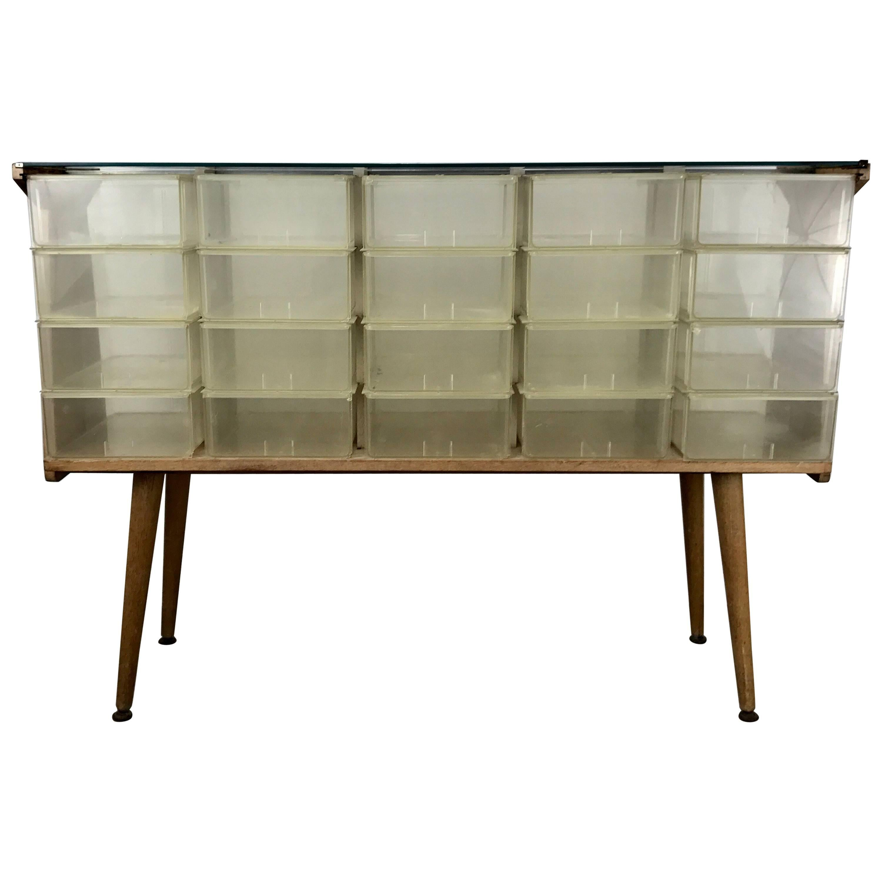Unusual mid century modern store fixture plastic wood and glass 20 cubbies for sale at 1stdibs