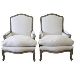 Pair of 20th Century Louis XV Style Painted and Upholstered Linen Bergere Chairs