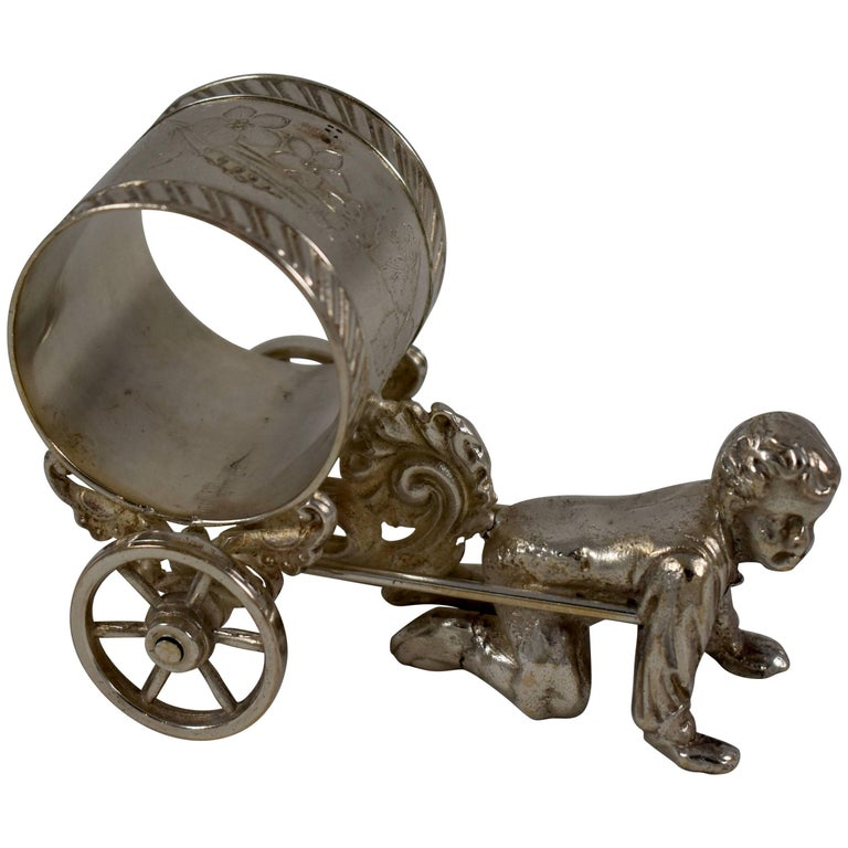 Silver Victorian Era Aesthetic Movement Figural Napkin Ring, Boy Pulling a Cart For Sale