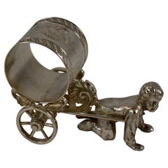 Silver Victorian Era Aesthetic Movement Figural Napkin Ring, Boy Pulling a Cart