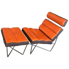 Unusual Chair and Ottoman Done in Orange Distressed Leather