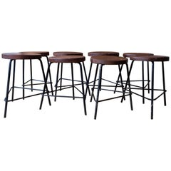 Pierre Jeanneret Grouping of Four Teak and Iron Stools from Chandigarh