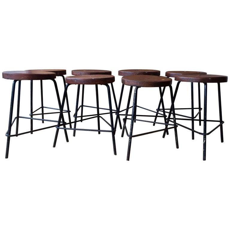 Pierre Jeanneret Grouping of Four Teak and Iron Stools from Chandigarh For Sale