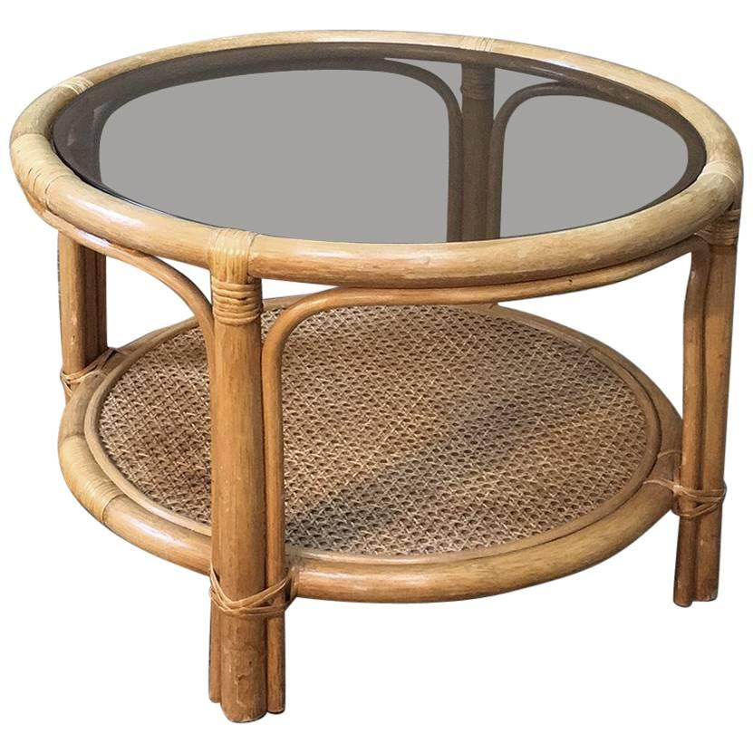 midcentury rattan coffee table with glass top