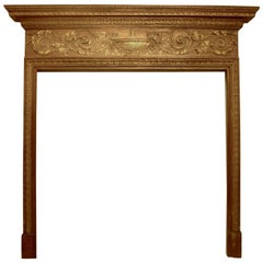 English Georgian Carved Pine Fireplace Mantle with Gilt Elements
