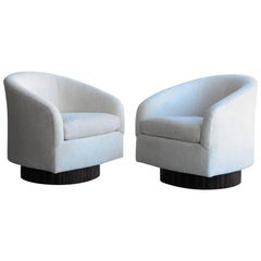 Pair of Plush Swivel Chairs with Macassar Bases