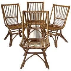 Four French Mid-Century Wicker Chairs