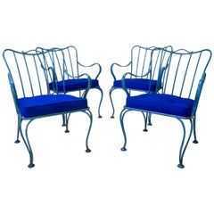 Four French Mid-Century Iron Lounge Chairs
