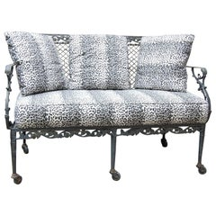Settee with Cast Iron Scroll Work and Wire Mesh Back in Regency Style