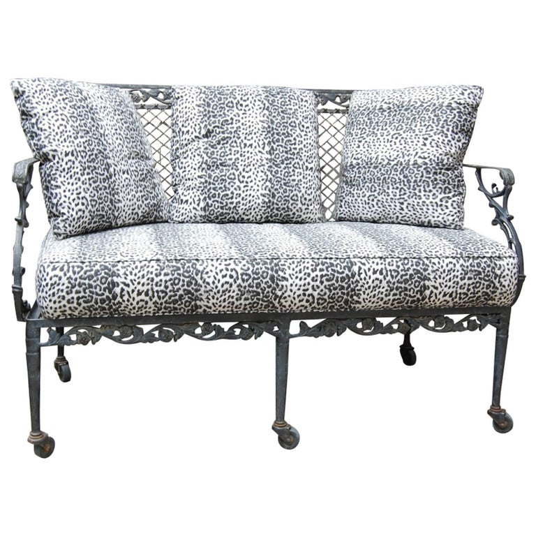 Settee with Cast Iron Scroll Work and Wire Mesh Back in Regency Style For Sale
