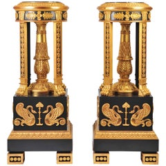 Grand Pair of Ebonized and Gilded Torchieres