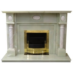 Green Onyx and Carved Marble Fireplace with Brass Frame and Fire Basket