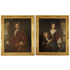 A large pair of 18th century portraits in gilded frames