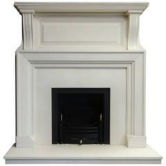 Edwardian Style Limestone Fireplace with Black Metal Frame and Fire Basket