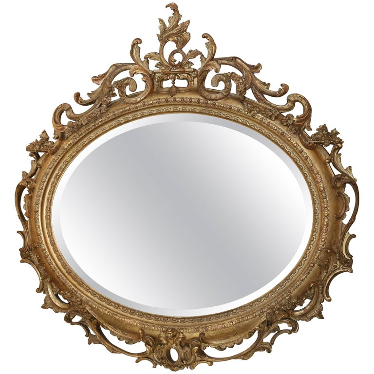 Pair of Louis Philippe Giltwood Oval Mirrors, 19th Century Rococo Revival Taste For Sale