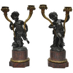 Pair of French Mid-19th Century Louis XVI Style Cherub Candelabras