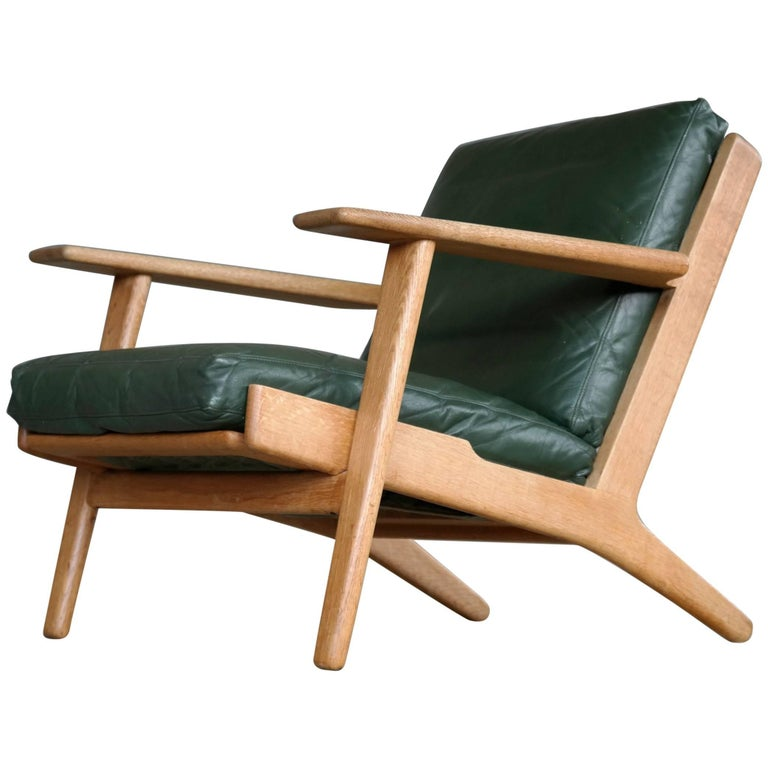 Hans Wegner Low Back Lounge Chair Model GE290 for GETAMA Oak and Green Leather For Sale
