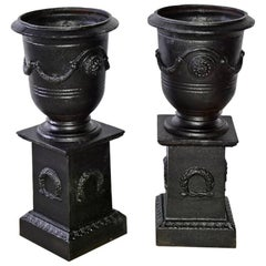 Pair of Vintage Neoclassical Style Urns on Pedestals