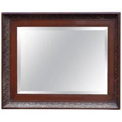 Mirror in Polished Mahogany and Faceted from circa 1920s