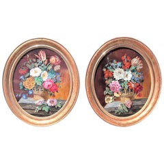 Pair of Églomisé  Paintings in Floral Engraved Giltwood Frames