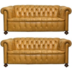Pair of Vintage Leather Chesterfield Sofas with Rolled Arms and Nailhead Trim
