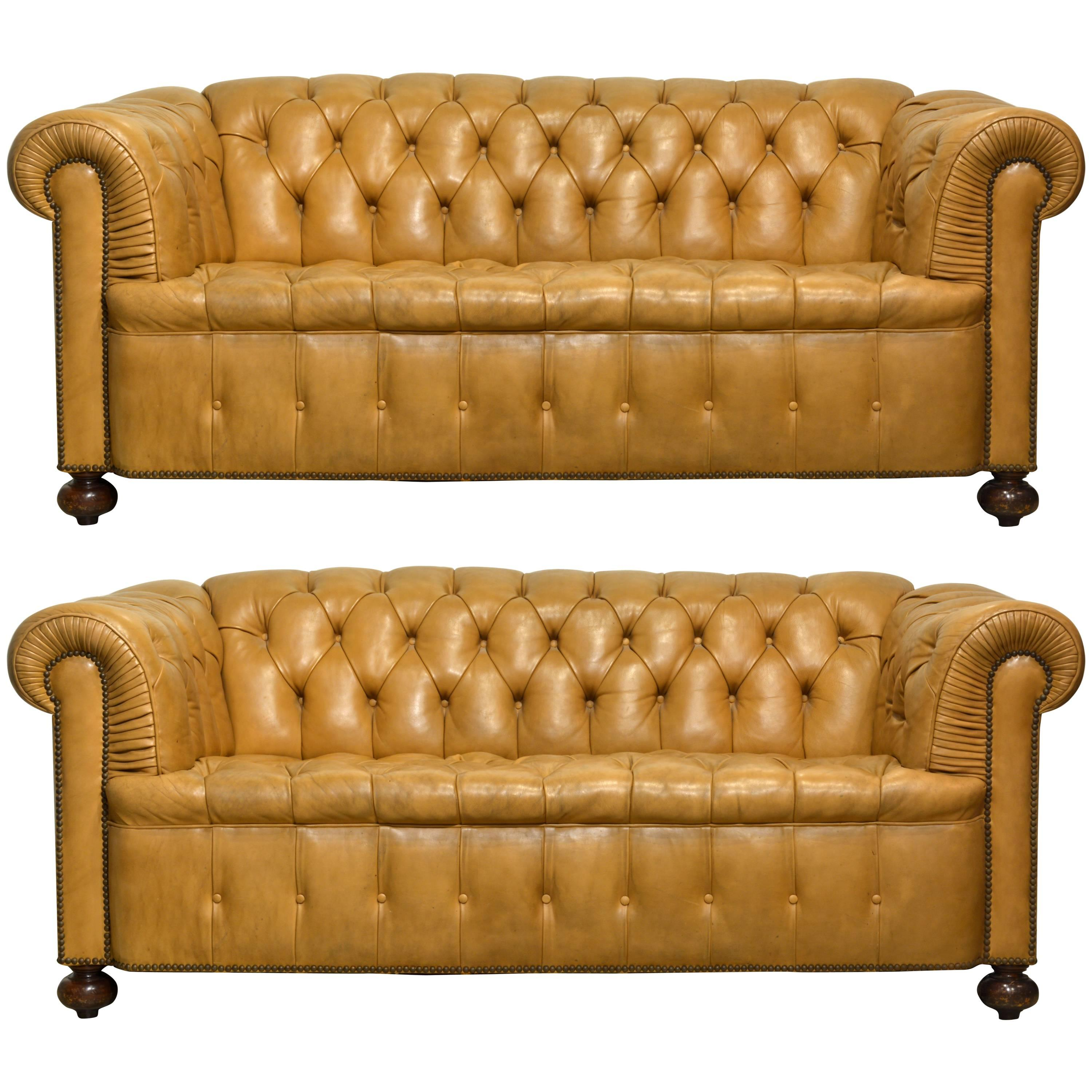 pair of vintage leather sofas with rolled arms and nailhead trim