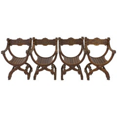 Four French Carved Oak Renaissance Revival Dagobert Chairs, 1900s