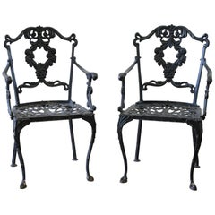 Pair of mid 19th century cast iron lyre back garden chairs Cast iron garden furniture