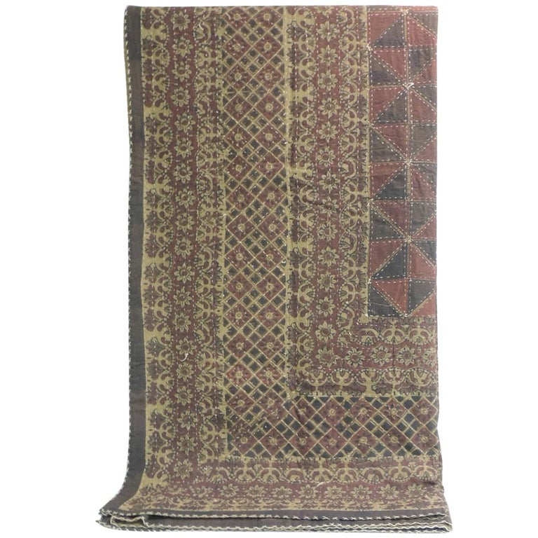 Large vintage quilted Indian Kantha king size blanket. In shades of red. brown, tan, yellow, red, deep blue and natural.