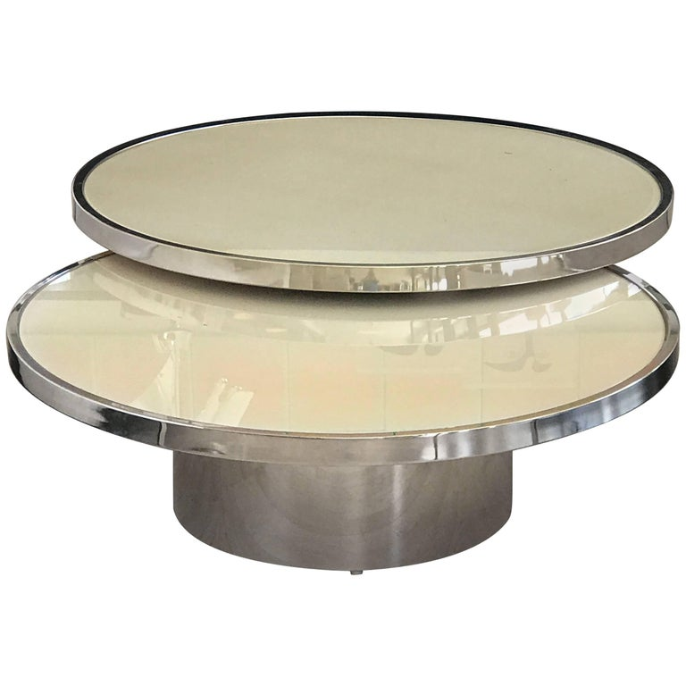 swivel coffee table with high polished steel base for sale