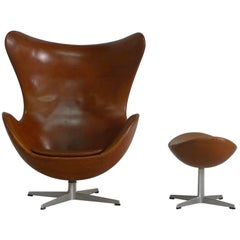 Arne Jacobsen Egg Chair and Ottoman in Original Brown Leather, Danish, 1960s