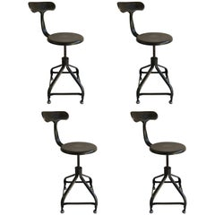 Four French Industrial Adjustable Stools
